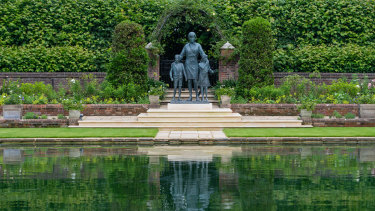 The statue of Diana, Princess of Wales, sits by the lake in the Sunken Garden at Kensington Palace.
