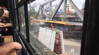Traffic, trains and trams in Richmond were disrupted on Friday after a truck hit the rail bridge on Swan Street.