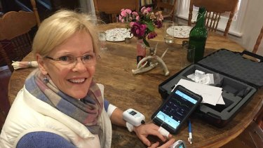 Kate Dight, Mary's neighbour and local councillor, wearing one of the remote monitoring devices.