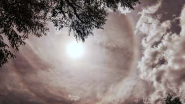 A sun halo appears in the sky over western Sydney on Saturday.