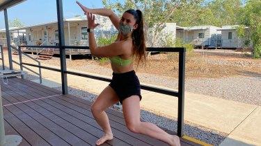 Kassidy Waters of Bangarra Dance Theatre exercising during 14 days of quarantine at Howard Springs.