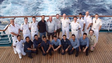 Pacific Dawn crew with the rescued men, top row, centre.