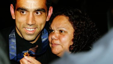 Goodes, with mother Lisa-May, collects his first Brownlow Medal in 2003.