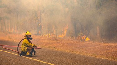 Local firefighters are fatigued and suffering from heat stress, but interstate reinforcements have eased the workload.