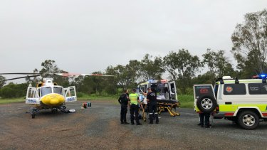 The RACQ CQ Rescue helicopter was forced to land at the Ilbilbie roadhouse, about 20 kilometres from the scene, due to poor weather.