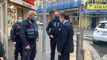 Christian Estrosi, the mayor of Nice, speaks to police at the scene of the attack.