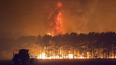 Volunteer firefighter Nikki Woods captured how tall the flames reached on Tuesday morning.