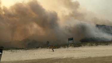 The view of the Fraser Island bushfire from Cathedral Beach on the eastern side of the island.
