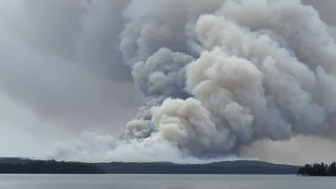 Photo taken west of the fire from St George's Basin looking east towards Booderee National Park.