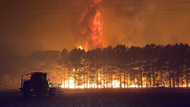 Volunteer firefighter Nikki Woods captured how tall the flames reached on Tuesday night.