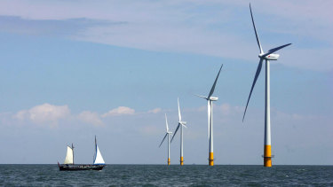 A vessel sails towards a wind farm off the coast of Whitstable on the north Kent coast in England.