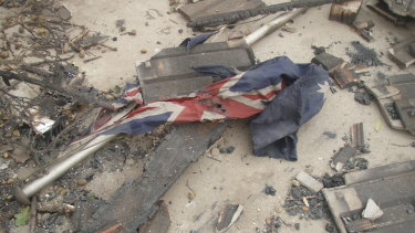 The flag as Sergeant Kevin Graham found it in the ruins of Marysville police station.