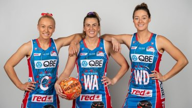 Swifts stars Tayla Fraser, Maddy Proud and Lauren Moore with their Indigenous Round uniform.