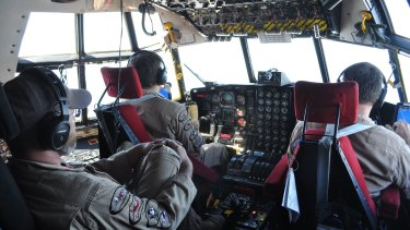 Inside the cockpit of a Hercules C-130.