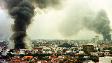 Smoke rises from burning buildings during Jakarta's unrest in May 1998.
