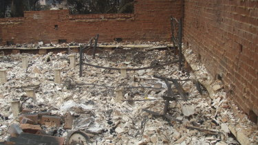 The remains of a bedroom at sergeant Kevin Graham's residence next door to the station.
