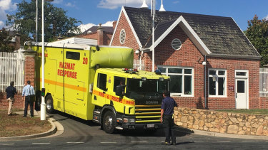 A hazmat response truck leaves the US Embassy in Canberra on Wednesday.
