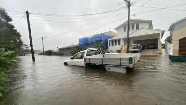 Flood waters make for treacherous driving in Narrabeen to Sydney's north.