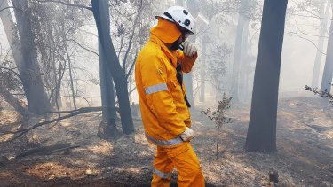 A firefighter tackles a bushfire near Binna Burra in September.