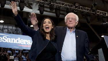 Democratic presidential candidate Bernie Sanders with congresswoman Alexandria Ocasio-Cortez in Durham, NH.