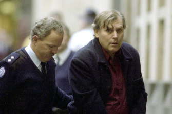 Bandali Debs is led into court in 2002.