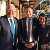 Jacob Sich (centre) pictured with Kiama MP Gareth Ward, who has since been appointed Minister for Family and Community Services, and Premier Gladys Berejiklian.