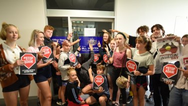 Young protesters outside Bill Shorten's office. His wavering on the Adani Carmichael coal mine has frustrated them.