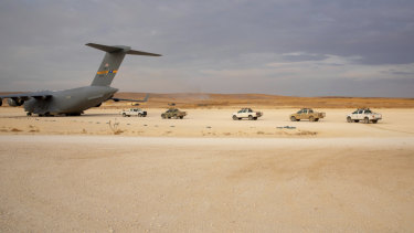 American vehicles line up to be loaded onto a cargo plane as part of the deliberate withdrawal of coalition forces from northern Syria last week.