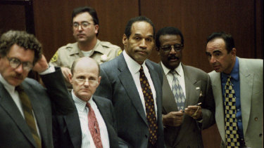 OJ Simpson (centre) is shown with members of his defence team as the jury enters the court in 1995. Alan Dershowitz is at far left.