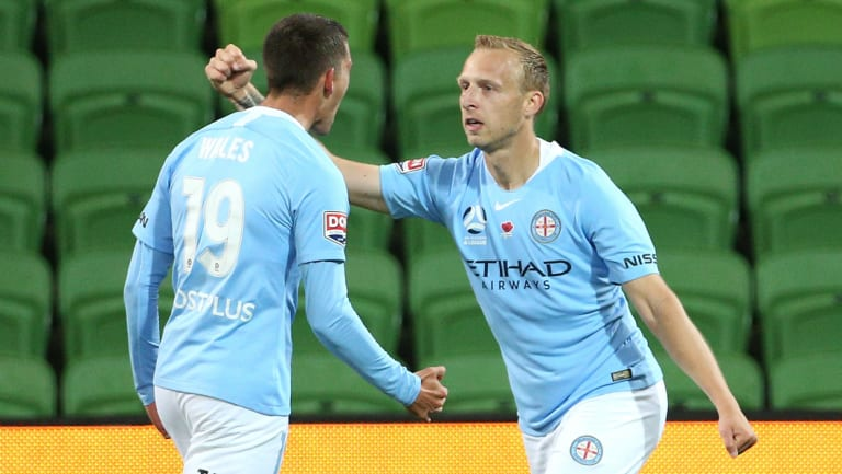 Ritchie De Laet (right) opens the scoring for Melbourne City.