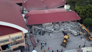 Workers continue rescue efforts for people still trapped inside a collapsed building at Porac town.