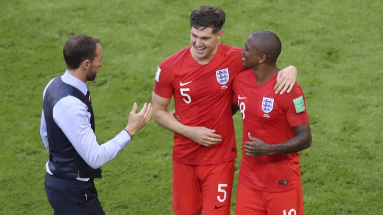 Gareth Southgate with John Stones and Ashley Young as they celebrate their quarter-final win.