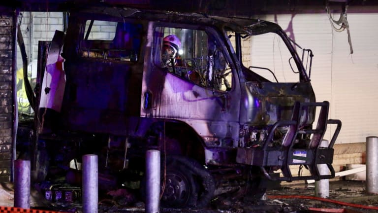 Arson squad detectives are investigating after a truck crashed into a Rockingham tattoo parlour, before a fire engulfed the shop.