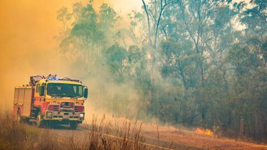 Firefighters work to control a bushfire in Deepwater, central Queensland, on November 30, 2018