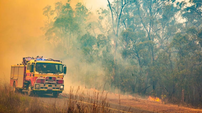 Firefighters work to control a bushfire in Deepwater, central Queensland, on November 30.