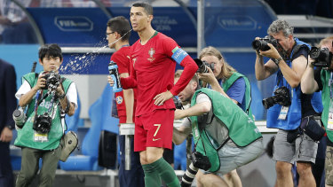 Aquatic Morse code: Portugal's Cristiano Ronaldo spits fluid during a World Cup match in Russia.