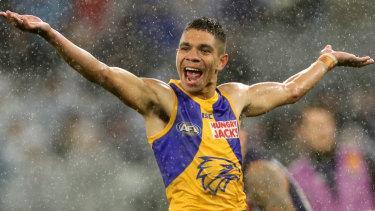 Derby downpour: West Coast's Jarrod Cameron celebrates a rain-drenched goal against Fremantle.