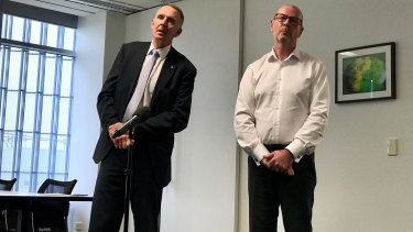 AAP chairman Campbell Reid and CEO Bruce Davidson announcing the closure in March. The newswire was rescued from closure months later.