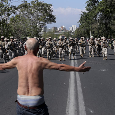 A man challenges soldiers during clashes in Santiago.