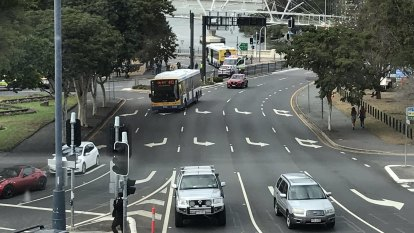 Motorcyclist killed after falling under bus in inner Brisbane