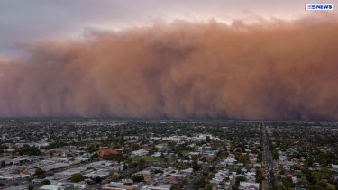 A dust storm rolls across the state's north-west.