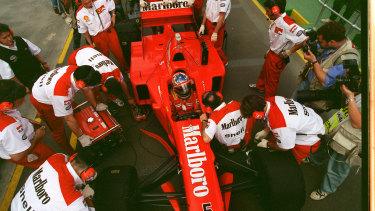 Ferrari mechanics work on Michael Schumacher's car at Albert Park in 1997.