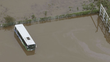 Busses are submerged in floodwaters after torrential rain in Sakura city, Chiba prefecture.