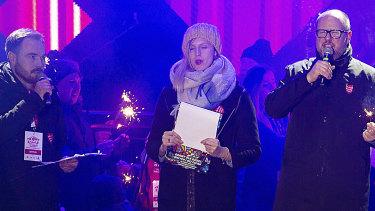 Gdansk Mayor Pawel Adamowicz, right, speaks to an audience shortly before he was stabbed in Gdansk, Poland.