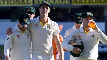 Respite: The Australians enjoy their win as they walk off the Gabba on day three.