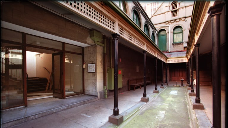 The courtyard of the Russell Street complex, with the staircase to courts 10 and 11 on the left through the glass doors. It was here that the death of Ray Chuck unfolded.