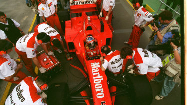 Ferrari mechanics work on Michael Schumacher's car at Albert Park in 1997.