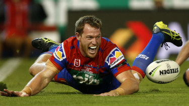 Touchdown: Tim Glasby scores for the Knights on his debut in the red and blue.