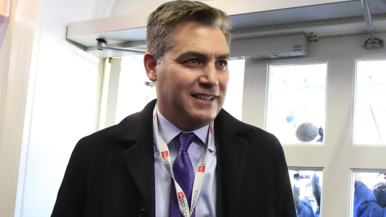 CNN's Jim Acosta enters the White House press briefing after having his access reinstated last week.