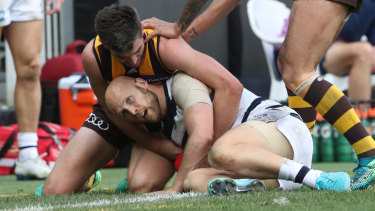 Contained: Gary Ablett is heavily tackled.